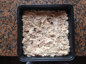 Put the bread pudding mixture in a greased baking tin and pop into your oven!