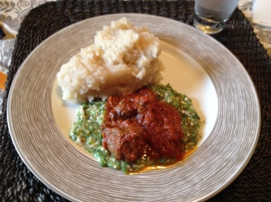 Eba (the white mass which is made from cassava), okro soup and tomato stew. Meal was served with beef.