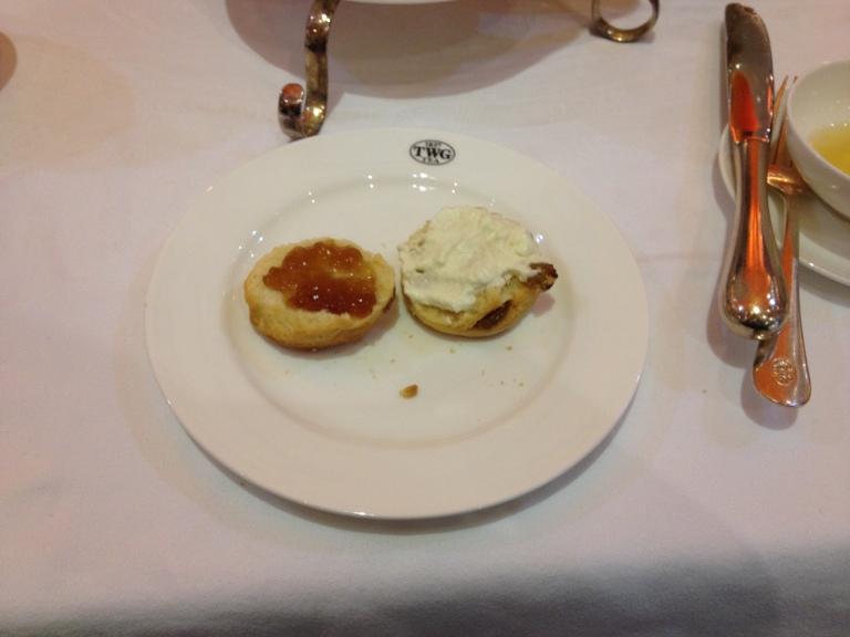 Left: Half a scone with TWG jelly. Right: Scone with clotted cream